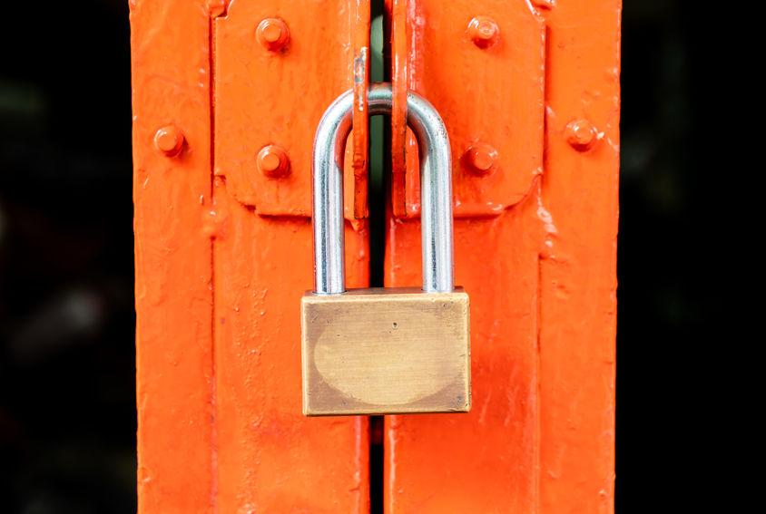 metal golden padlock on a door